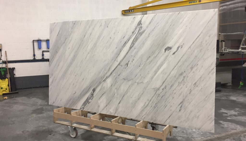 slab of Carrara marble in Everything Stone factory - cost of granite worktops versus cost of quartz worktops