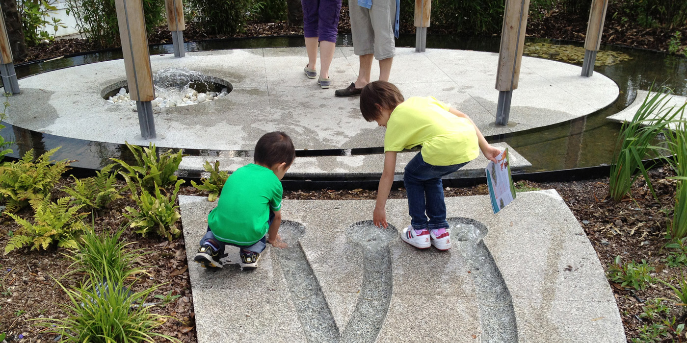 children playing at a garden installed by Everything Stone at the Eden Project in Cornwall
