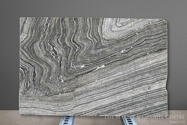 veiny slab of marble - cost of granite worktops versus cost of quartz worktops