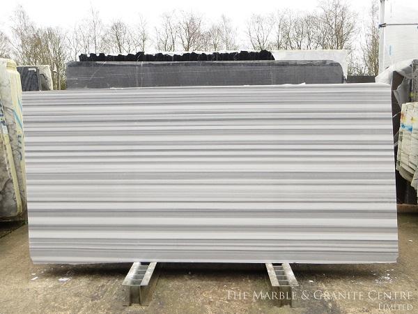slab of marble - cost of granite worktops versus cost of quartz worktops