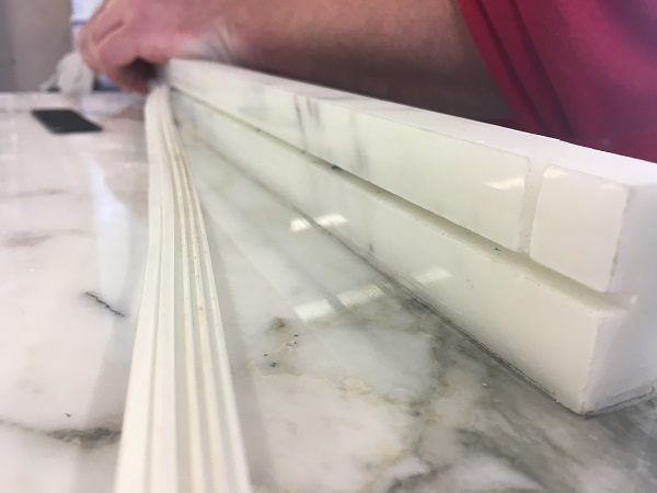 installing rubber gasket into marble shelf by Everything Stone