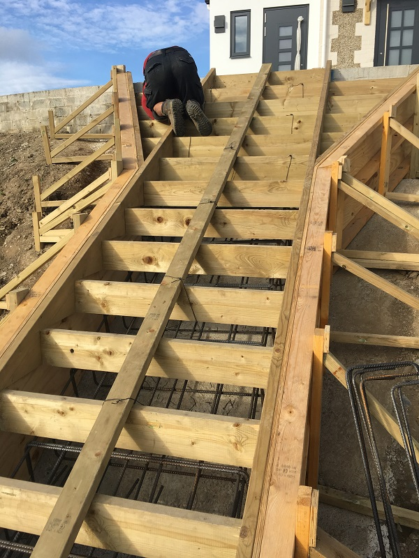 constructing the timber shuttering for a staircase, we install reinforcing steel such as starter bars, steel link bars and steel reinforcing mesh.