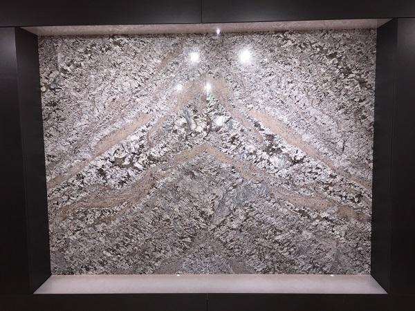 Book match lennon granite in Everything Stone showroom - cost of granite worktops versus cost of quartz worktops