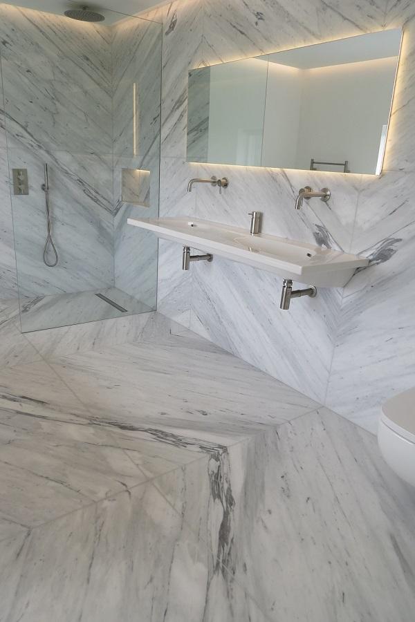 Carrara marble bathroom installed by Everything Stone - cost of granite worktops versus cost of quartz worktops