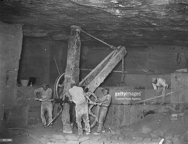 old photo showing men working in an under ground bath stone quarry