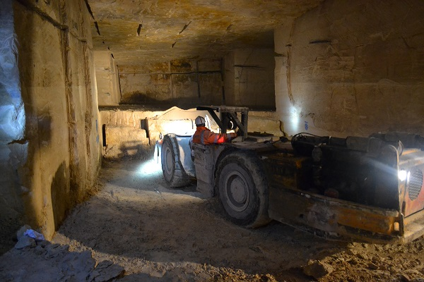 large fork lift being operated in under ground bath stone quarry