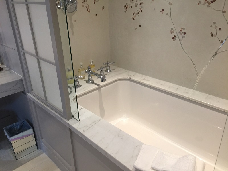 marble stone bath surrounds by everything stone